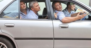 Composite of four of the same man in a car looking lost