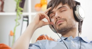 man in earphones relaxing