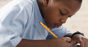 Boy writing at school
